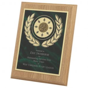Lightwood Presentation Plaque 20cms made from a MDF based material with a light wood colour finish and a sturdy strut on the rear. Incorporating green marble effect brass base metal front.