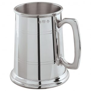 Pewter Tankard One Pint. Constructed from English pewter by expert craftsmen. Two sets of horizontal pressed lines running around the tankard. Supplied in a packing box. Also incorporating a plain handle.