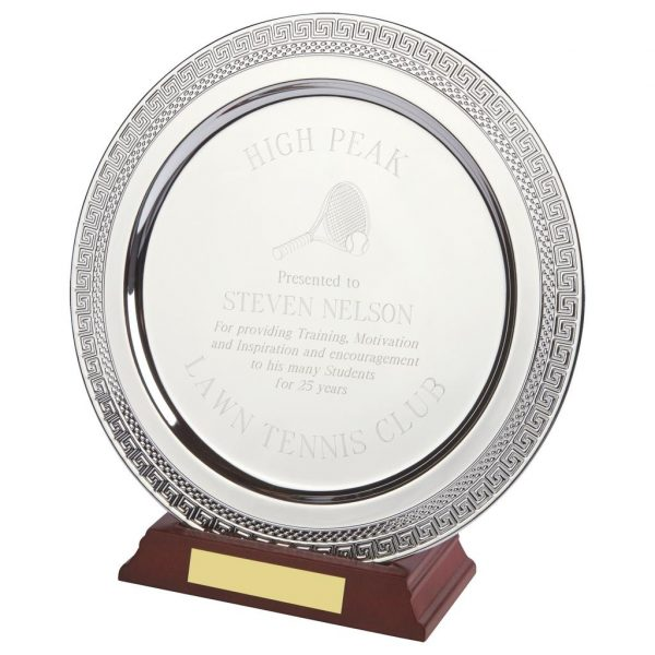 Achievement Salver 25cms. Constructed from a circular shaped metal alloy with a bright shiny silver finish and sits in a slotted wood base. Incorporating large area on the salver to include all your engraving including your club or corporate logo.