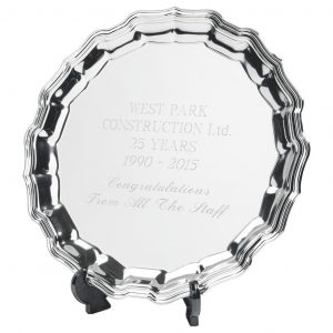 Silver Plated Chippendale Salver 20cms. Made from a metal alloy with a bright shiny finish and a plastic plate stand. Incorporating large area to include any engraving if required.