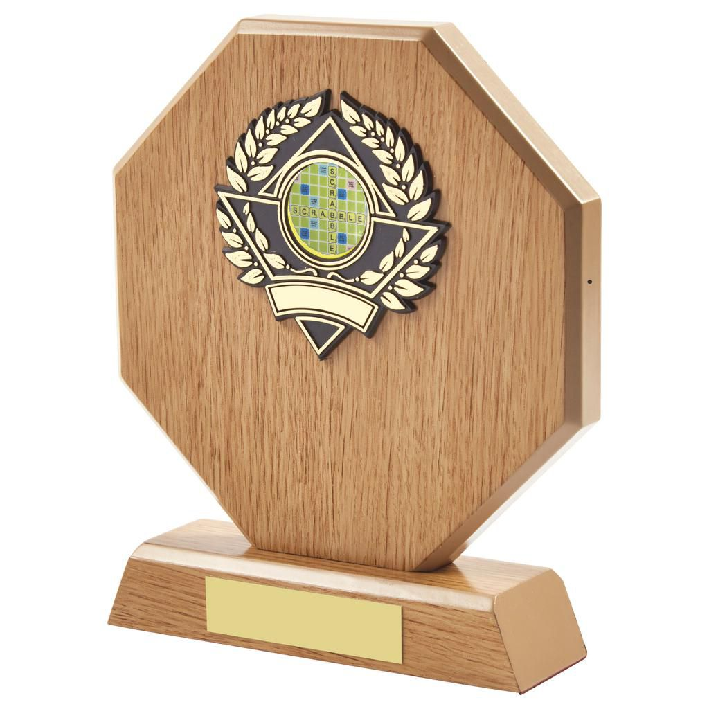 lightwood coloured scrabble trophy is hexagon shaped and includes a standard coloured scrabble centre