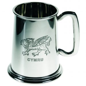 Welsh Dragon Tankard. Constructed from English pewter by expert craftsmen. A traditional tankard including the Welsh dragon embossed logo. Presented in a standard packing box. Also incorporating a rounded handle and lots of room for etching