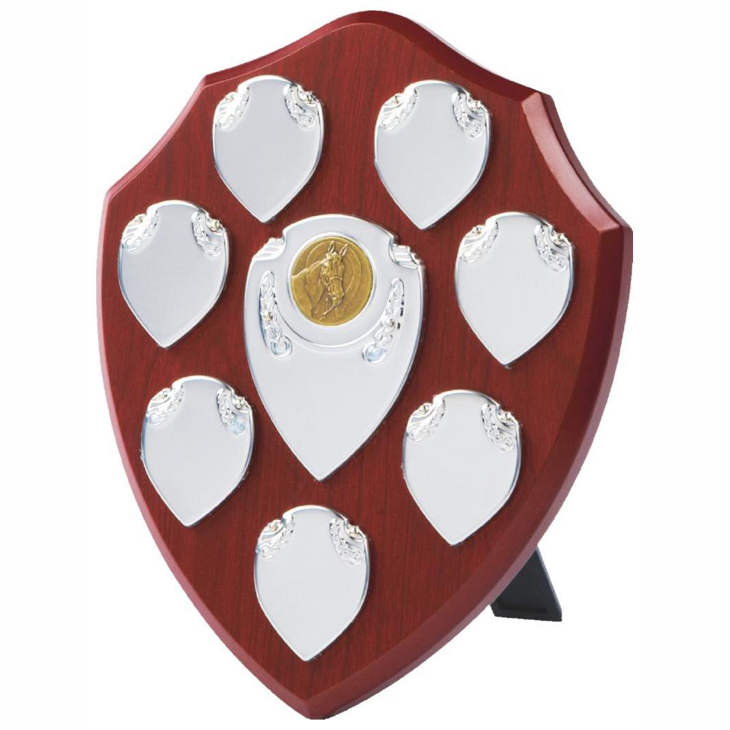 Annual Perpetual Shield 20cms tall made from a MDF based material with a hard wearing rosewood colour finish and a sturdy strut on the rear. Incorporating seven small record shields, and chrome coloured centre embellishments.