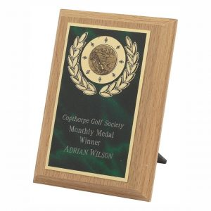 Lightwood Presentation Plaque 15cms made from a MDF based material with a light wood colour finish and a sturdy strut on the rear. Incorporating green marble effect brass base metal front.