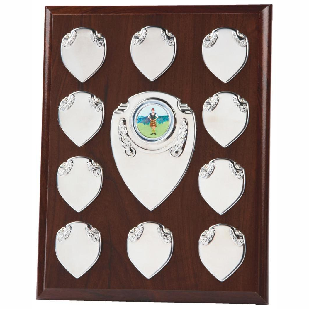 Annual Presentation Plaque 23cms made from a MDF based material with a dark colour finish and a sturdy strut on the rear. Incorporating ten small record shields, and chrome coloured centre embellishments.