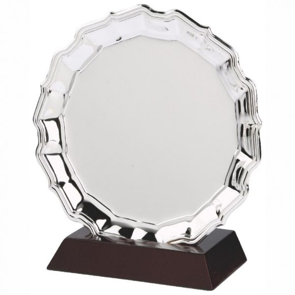 Nickel Plated Salver and Base 20cms dia. Made from a metal alloy with a bright shiny finish and rosewood slotted base. Incorporating large area to include any engraving if required.