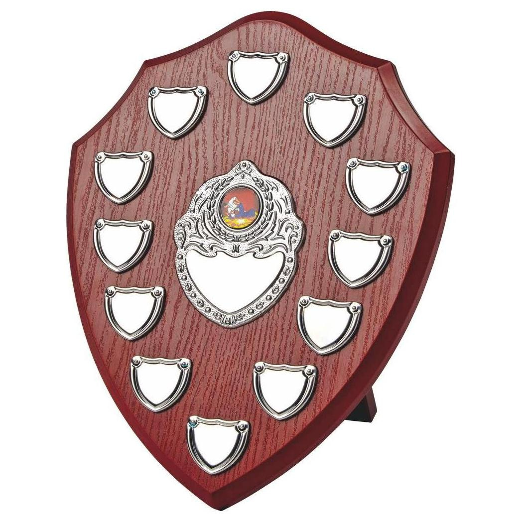 Clearance Line Presentation Shield 30cms Made from a MDF based material with a hard wearing rosewood colour finish and a sturdy strut on the rear. Incorporating eight  small record shields and chrome coloured centre embellishments.