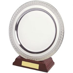 Achievement Salver 20cms. Constructed from a circular metal alloy with a bright shiny silver finish and sits in a slotted wood base. Incorporating large area on the salver to include all your engraving including your club or corporate logo