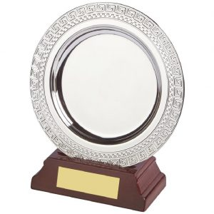 Achievement Salver 13cms. Constructed from a circular metal alloy with a bright shiny silver finish and sits in a slotted wood base. Incorporating large area on the salver to include all your engraving including your club or corporate logo