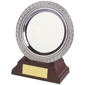 Achievement Salver 10cms. Constructed from a circular metal alloy with a bright shiny silver finish and sits in a slotted wood base. Incorporating large area on the salver to include all your engraving including your club or corporate logo