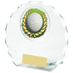 Golf Glass Budget Trophy 10cms. Constructed from 5mm thick jade coloured scalloped edge circle glass. Incorporating a golf ball in wreath glass disc image