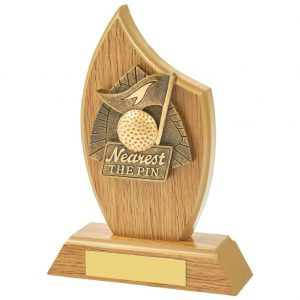 Nearest Pin Wood Trophy. Constructed from a light-wood coloured mdf sail shape hard material. Incorporating a high relief two tone resin longest drive icon