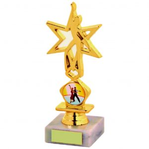 Star Dancing Trophy 16cms. a gold coloured hard plastic composite star figure. A medium riser bell. All connected to a piece of white marble