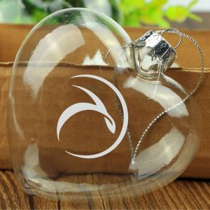 A heart shaped glass etched T on the bauble. 80mm  x 80mm. A perfect hostess gift, game prize or Tropic Ambassador incentive award.